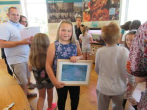 Iona Gillie, our art competition overall winner, with a framed print of her picture.